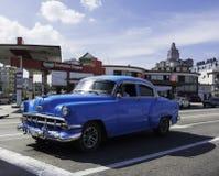 Classic American car stops in Havana, Cuba. HAVANA, CUBA - DECEMBER 12, 2016 - Vintage car parked on a street in Vedado, Havana, Cuba Royalty Free Stock Photos
