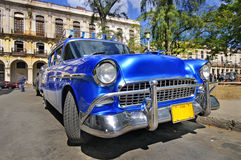 Classic american car in the street of havana. Blue classic american car in havana street with eroded buildings in the background, cuba Stock Photo