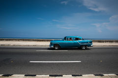 Classic american car on street of Havana in Cuba. Havana, Cuba - September 21, 2015:  Classic american car drive on Havana most popular sea fron promenade, El Stock Photo