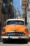 Classic American cars and Capitol in Havana, Cuba. Royalty Free Stock Photo