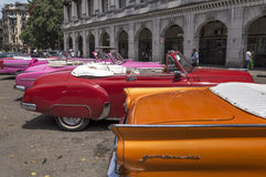 Classic american cars in Havana, Cuba. Colourful row of classic american cars in havana, Cuba royalty free stock photo