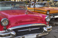 Classic american cars in Havana, Cuba. A couple of old and colourful american cars parked in front of Capitolio, Old Havana, Cuba royalty free stock photos