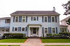 Classic American clapboard suburban house. Clapboard suburban house in classic American-style Royalty Free Stock Photography