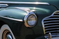Classic Buick car detail closeup. Classic American closeup details. 1940s Buick Special Eight sedan under the sun. Miami, Florida royalty free stock image