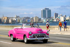 Classic american convertible car  at the famous Malecon avenue i Royalty Free Stock Photography