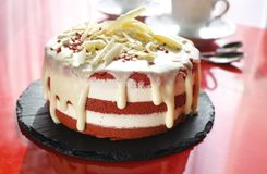 Classic American dessert red velvet cake is traditionally a red, red-brown chocolate layer cake. Layered with white cream cheese or ermine icing from bakery Royalty Free Stock Photo