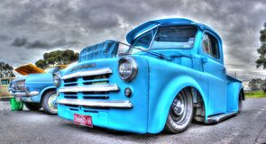 Classic American Dodge pick up truck. Classic blue American Dodge pick up truck on display at car and bike show in Melbourne, Australia on a cloudy and wet royalty free stock photography