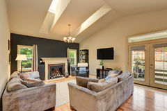 Classic American family room with fireplace and sofas Stock Photos