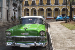 Classic american green car in Havana, Cuba. An old american car parked in front of a colonial house in Havana, Cuba Stock Image