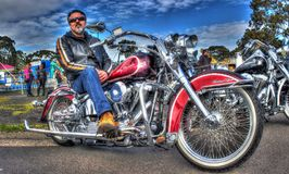 Classic American Harley Davidson motorcycle and owner Stock Images