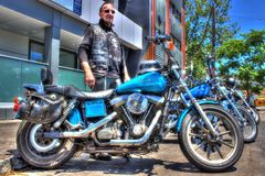 Classic American Harley Davidson and rider. Classic American blue Harley Davidson motorcycle and rider at a bike show held in Melbourne, Australia royalty free stock photos