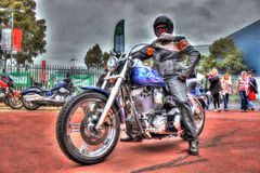 Classic American Harley Davidson with rider. Classic American blue Harley Davidson motorcycle with rider at Moto Expo a bike show held in Melbourne, Australia royalty free stock photography