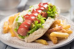 Classic american hot dog. Sandwich with pork or beef sausage Royalty Free Stock Photo