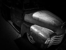 Classic American Hotrod Ratrod. On black background with chrome grill and headlight and chrome rims Royalty Free Stock Photos