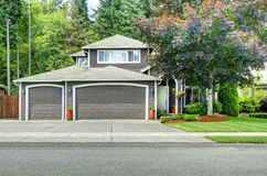 Classic american house with two car garage and driveway Royalty Free Stock Image