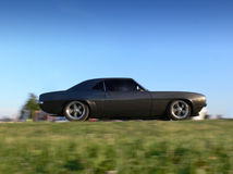 Classic American Muscle Car on the Move Royalty Free Stock Image