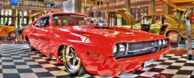 Classic American Muscle car. Red 1970s Dodge muscle car with large exposed motor on display at the 2016 Victorian Hot Rod Show held in Melbourne Australia Stock Photos