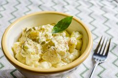 Classic American potato salad made with creamy mayonnaise dressing.
