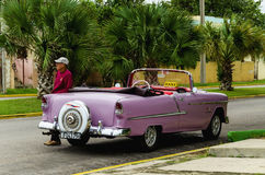Classic American purple car on Havana street Stock Photo
