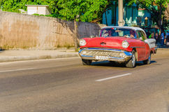Classic American red car in Havana, Cuba Royalty Free Stock Images