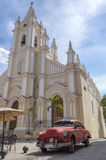 Classic american red car in Havana, Cuba. An old american car parked in front of a church in Old havana, Cuba Stock Image