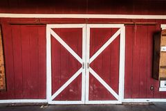 Classic american red  and white barn wooden doors.  Royalty Free Stock Images