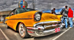 Classic American 1950s Chevy. Classic yellow 1950s Chevy on display at car and bike show in Melbourne, Australia Royalty Free Stock Photos