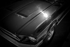 Classic American Sports Retro Auto. On black background with chrome grill and headlight and chrome rims Royalty Free Stock Image