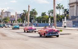 Classic American taxi cars in Centre of Havana City, Cuba. Havana, Cuba-October 8,2016. Classic American taxi cars with passengers pass in front of the stock image