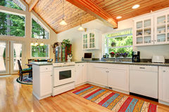 Classic American white kitchen interior with granite counter to. P and hardwood floor. Open floor plan. Northwest, USA Stock Photos