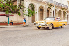 Classic American yellow car on street of Havana Royalty Free Stock Photos