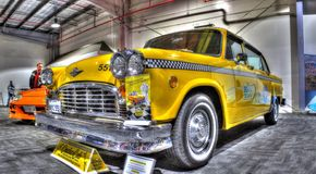 Classic American yellow checkered taxi cab Royalty Free Stock Image