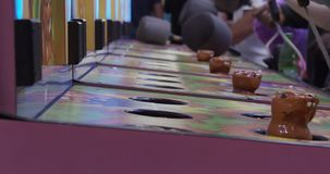 Classic americana whacking carnival game. Shot in 4K RAW on a cinema camera stock footage