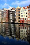 Classic Amsterdam houses with reflections Stock Photo