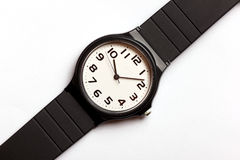 Classic analog black and white wrist watch on the  background. Classic analog black and white wrist watch on the white background, close up Stock Photo