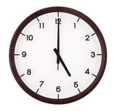 Classic analog clock. Pointing at 5 o'clock, isolated on white background stock images