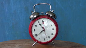 Classic analogue red alarm clock arrow motion stock video footage