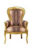 Classic ancient armchair with golden wood isolated Royalty Free Stock Images