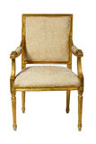 Classic ancient armchair with golden wood  isolated Royalty Free Stock Photography