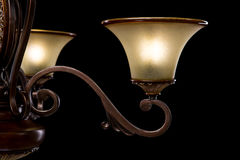 Classic ancient shandelier isolated on black background. Details. Classic ancient old Chandelier isolated on black background. Chandelier lamp for the living Royalty Free Stock Photos