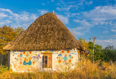 Classic ancient Ukrainian house with haulm roof Royalty Free Stock Images