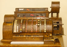 Classic Antique Cash Register. A classic old wood cash register with keys Stock Image