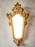 Classic antique mirror with gilded frame suitable as a frame or Stock Photo