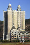 Classic apartement building in Dlaian, China. DALIAN-NOV. 9, 2012. Apartments at Dalian Xinghai Square on Nov. 9, 2012. City square located to the north of Royalty Free Stock Images