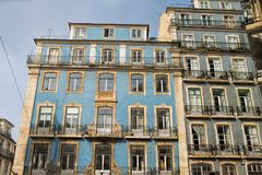 Classic apartment building exterior facade in Lisbon, Portugal.  stock photos