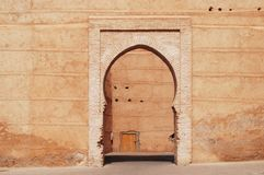 Classic arch architecture style enterance. Ocher color, classic arch architecture style enterance, medina, Marrakesh, Morocco Royalty Free Stock Image