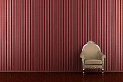 Classic armchair in front of red striped wall Stock Photos
