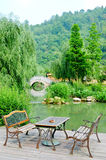 Classic Armchair and wonderful garden. Classic Armchair in the Chinese Garden Royalty Free Stock Images
