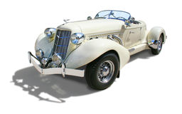 Classic Auburn Boattail Speedster- isolated. Auburn 852 Boattail Speedster Super-Charged 1936- Single view 3/4 front. Cream color, isolated over white Royalty Free Stock Photography