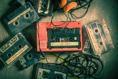 Classic audio cassette with walkman and headphones Royalty Free Stock Photos